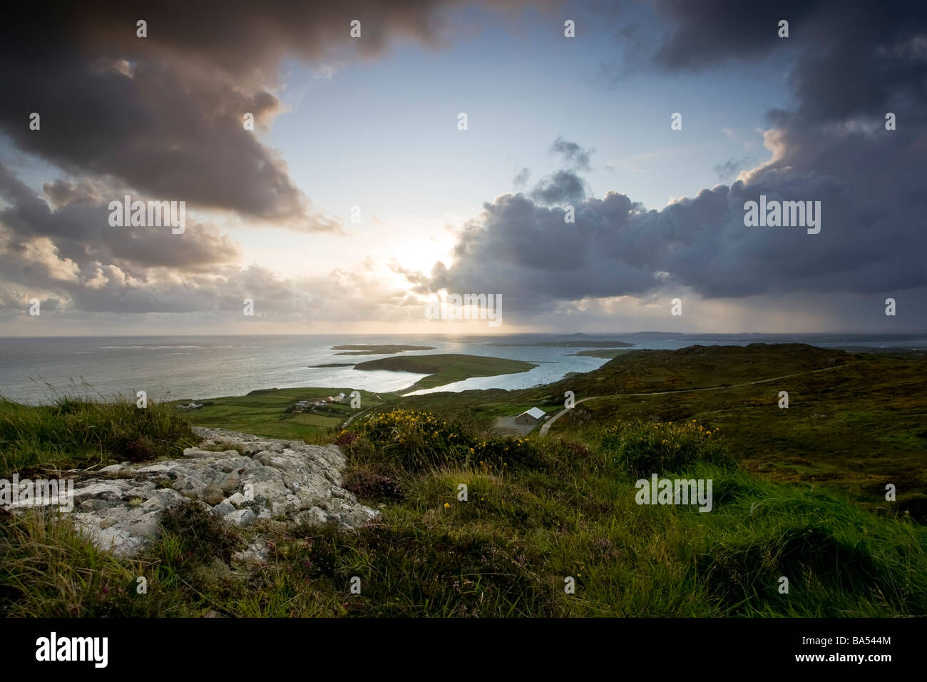 view over looking the west of ireland near the town of Clifden in the heart of conneamara County Galway at sunset Stock Photo