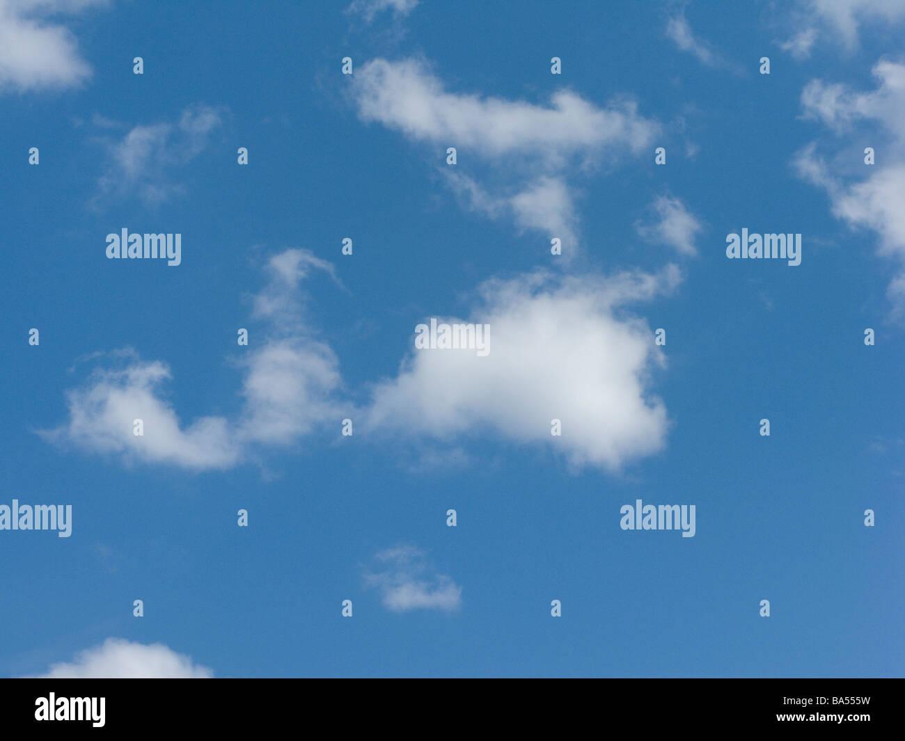 Cumulus Clouds in a Deep Blue Sky - Stock Image