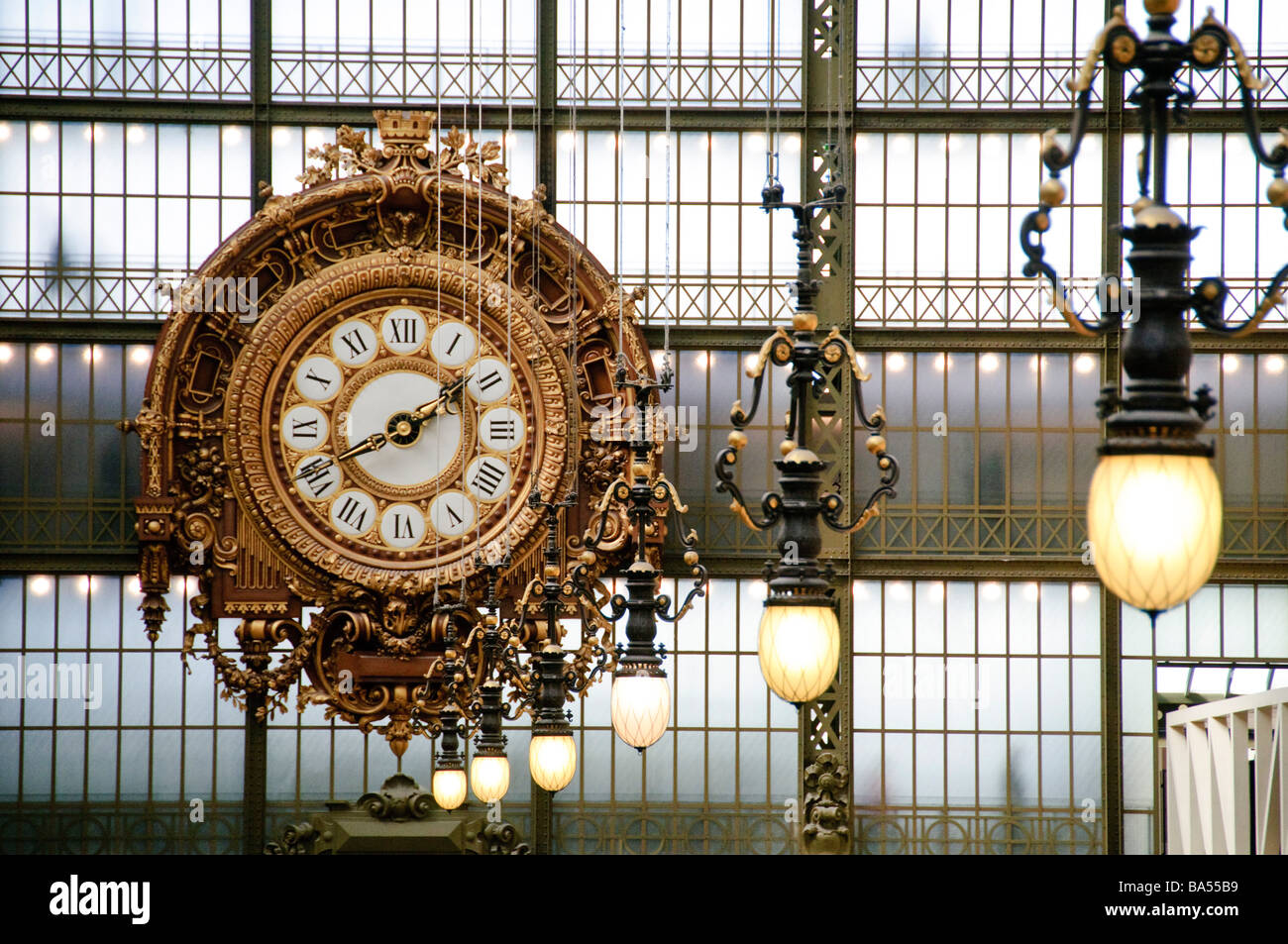 PARIS, France - Ornate clock in the main hall of the Musée d'Orsay - Stock Image