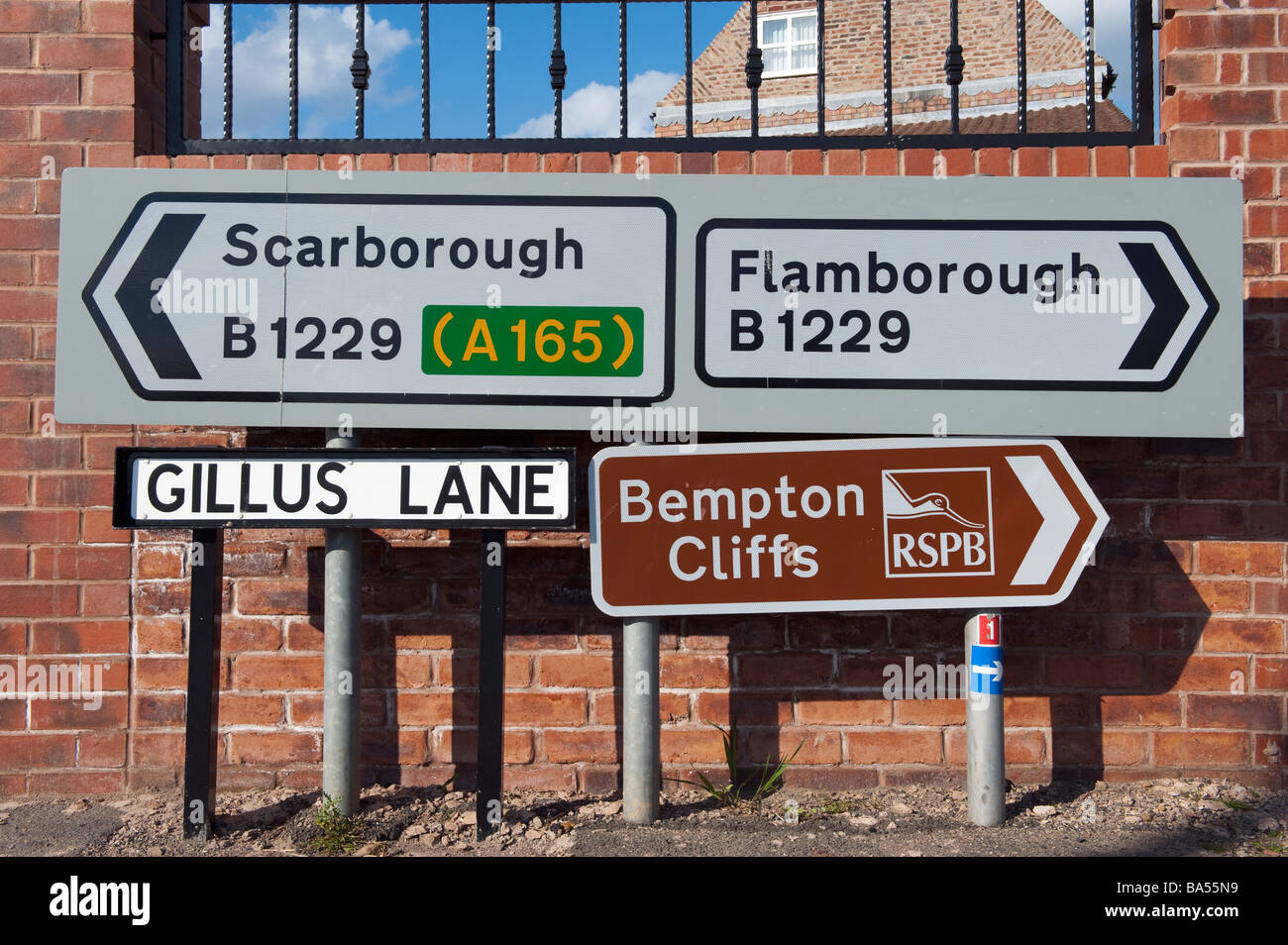 Signpost and signs on a street corner pointing to RSPB on Bempton Cliffs,'East Riding',Yorkshire, England, - Stock Image