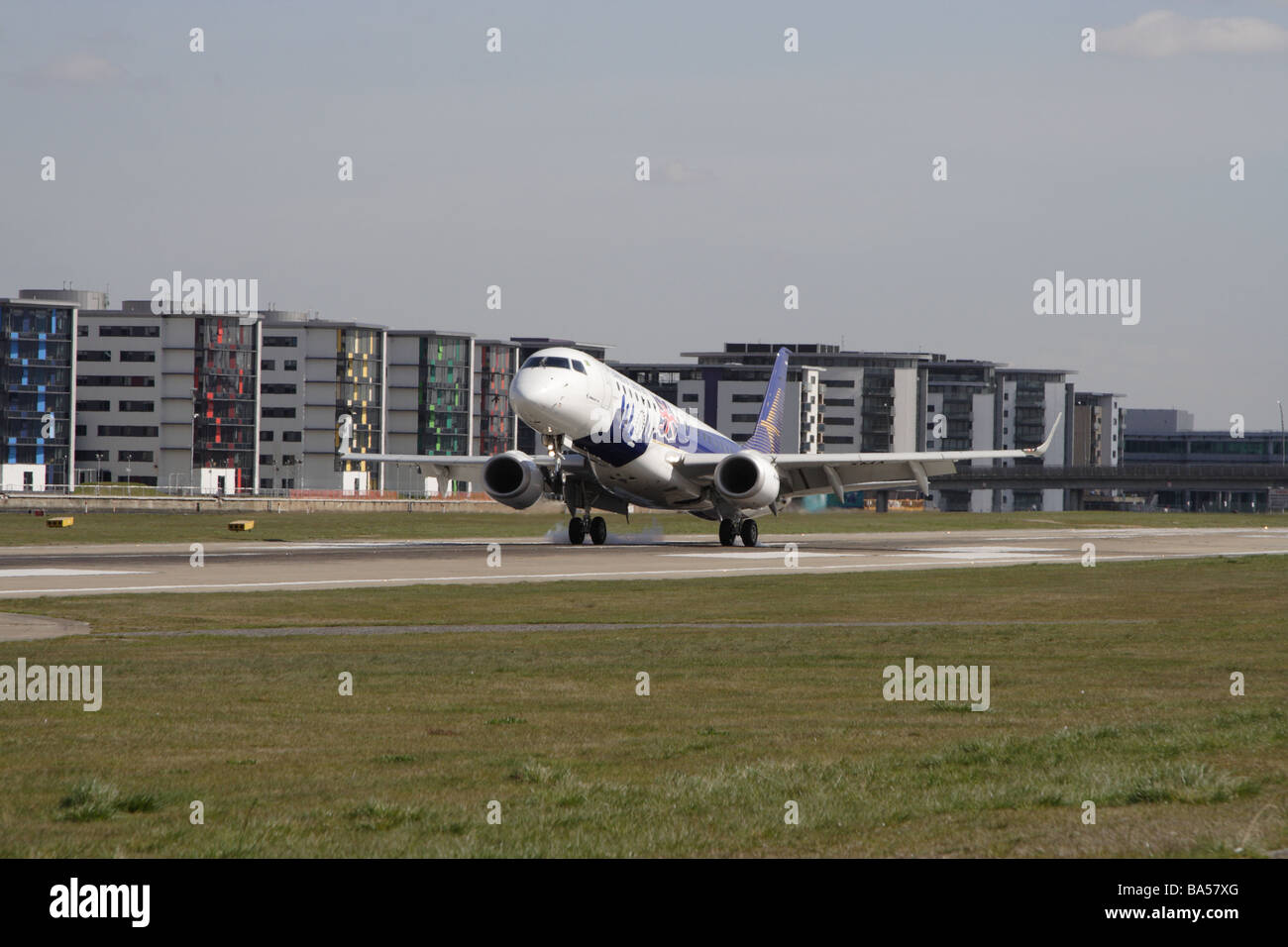 Embraer E190 Landing London City Airport - Stock Image