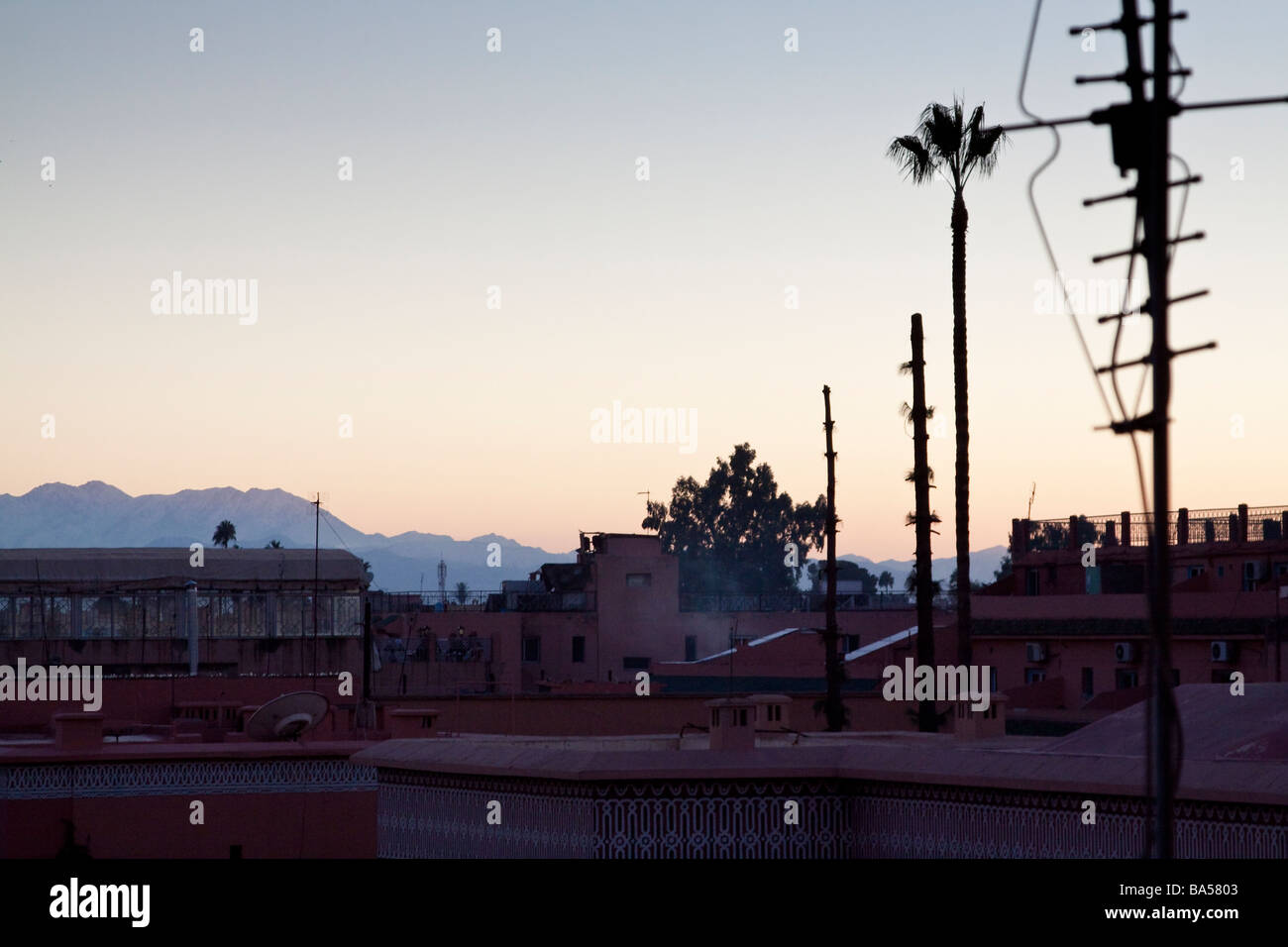 Early morning sunrise in the Medina of Marrakech with the Atlas mountains in the background - Stock Image