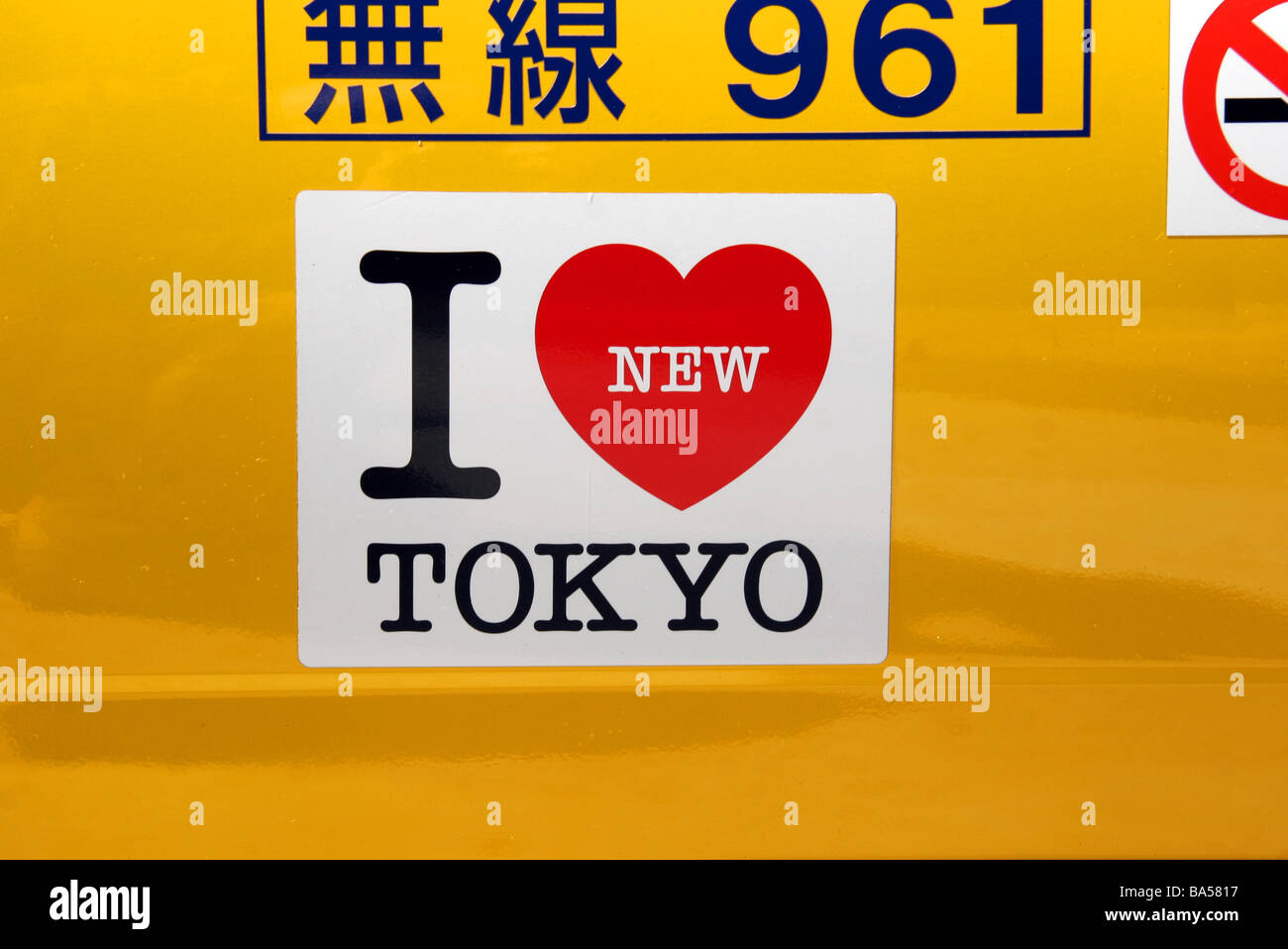 I Love Tokyo sticker on door of yellow taxi cab in Tokyo Japan - Stock Image