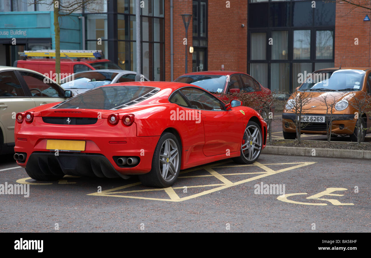 ferrari car parked inconsiderately in a disabled parking bay - Stock Image