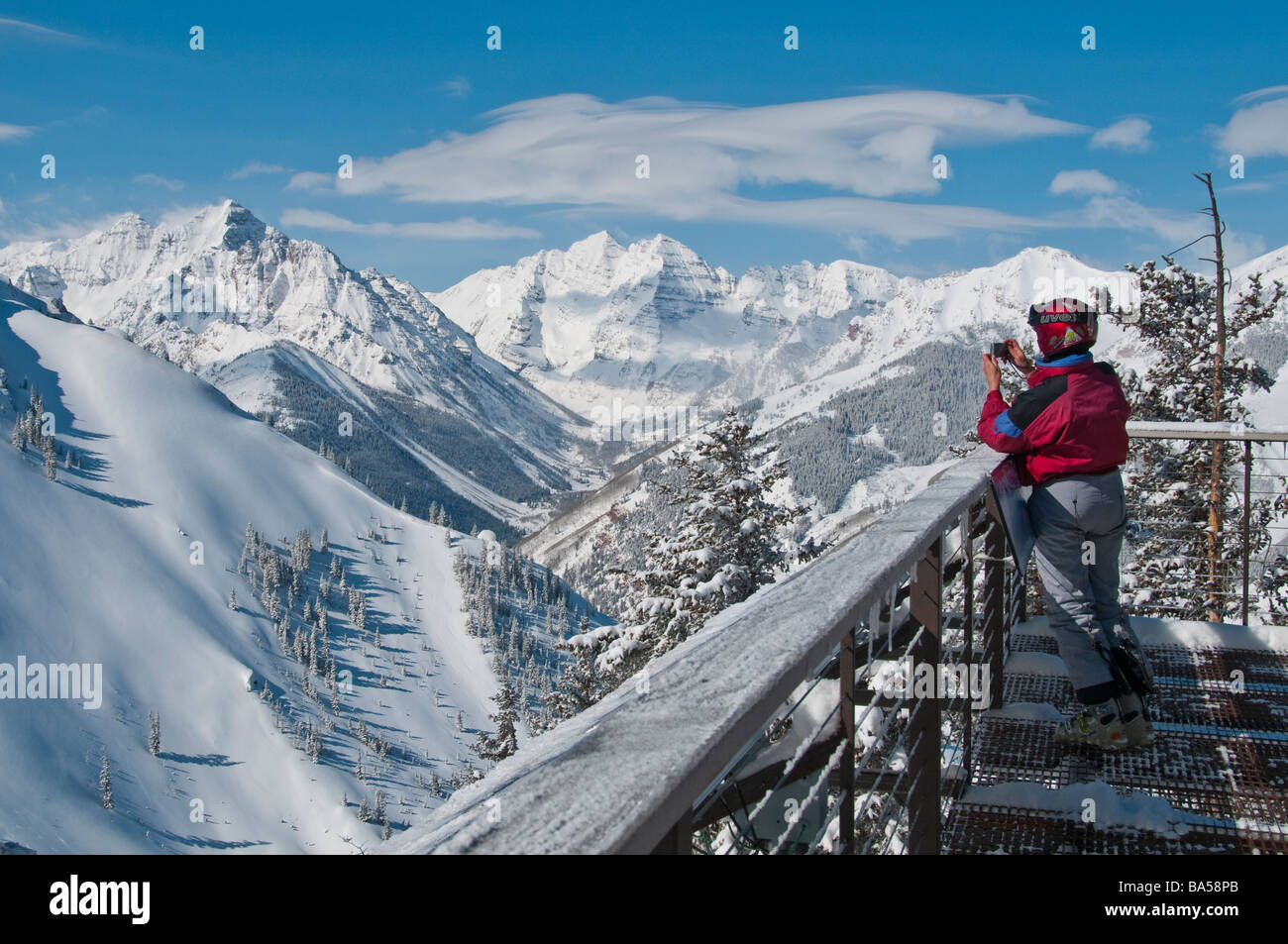Woman Photographs Pyramid Peak And Maroon Bells From The