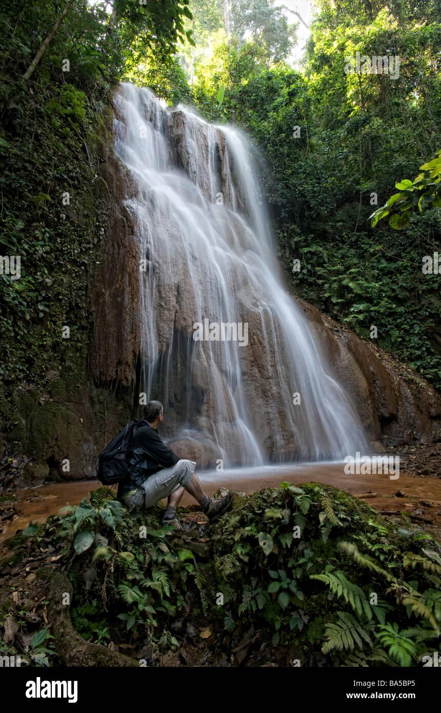 Hiker resting at Mae Sawan Noi Waterfall located in Mae Hoh or Mae Haw Amphur Mae Sariang Mae Hong Son Thailand - Stock Image