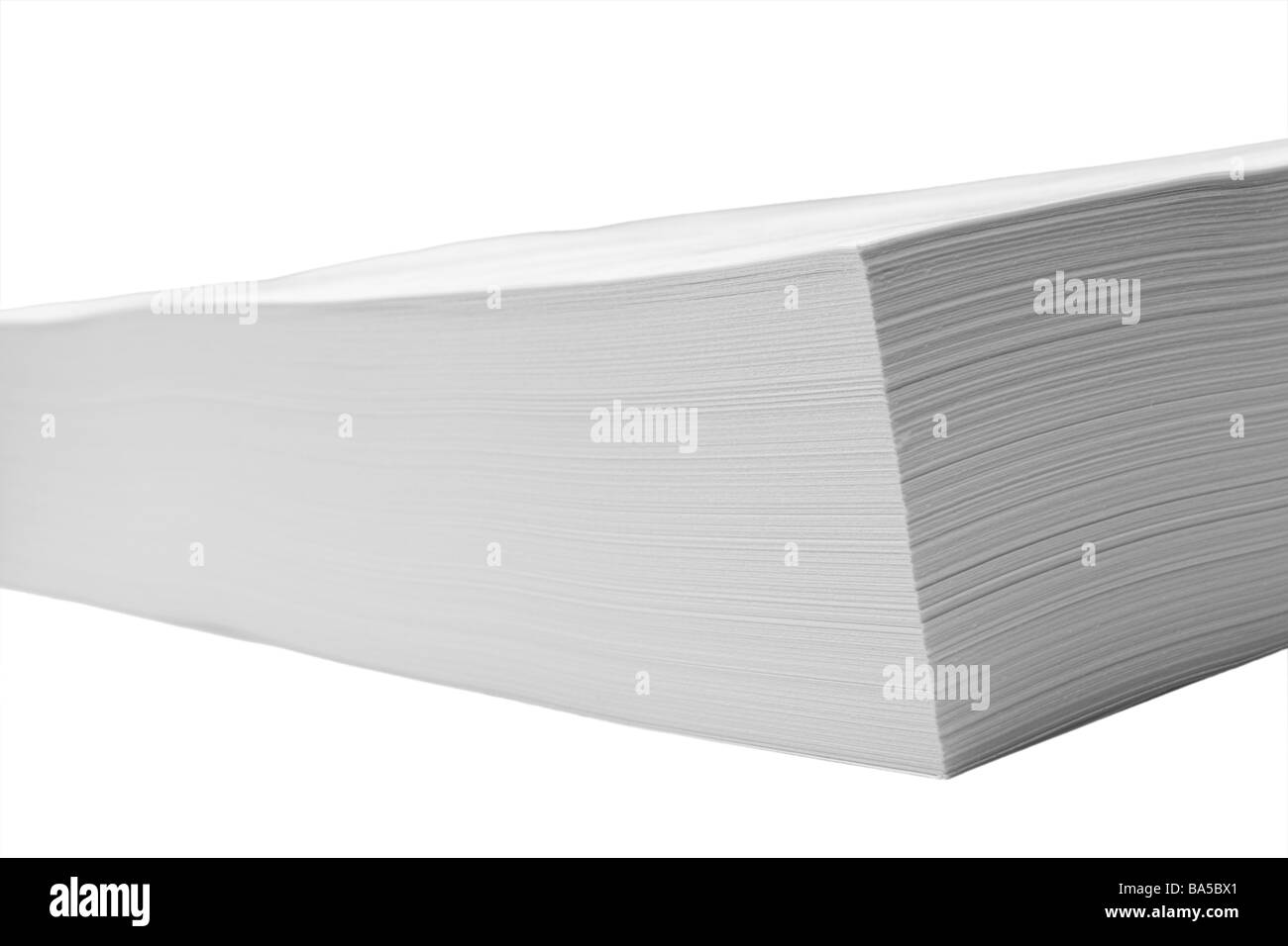 Close-up corner edge view of ream, stack of letter size white paper, black and white, selective focus, isolated - Stock Image