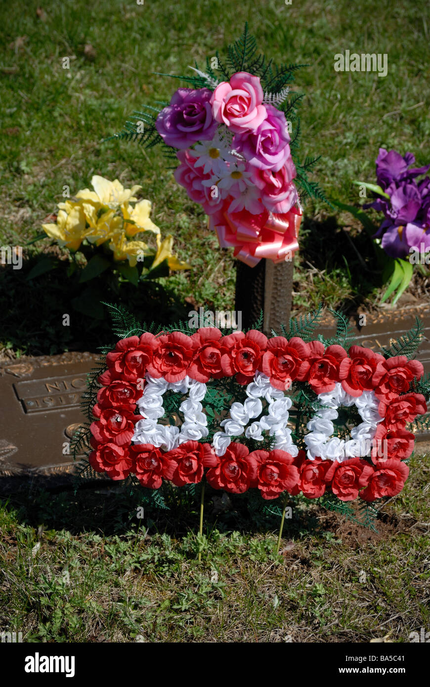 Tomb flower arrangement stock photos tomb flower arrangement stock flowers and a dad memento decorate a grave in allegheny cemetery pittsburgh izmirmasajfo