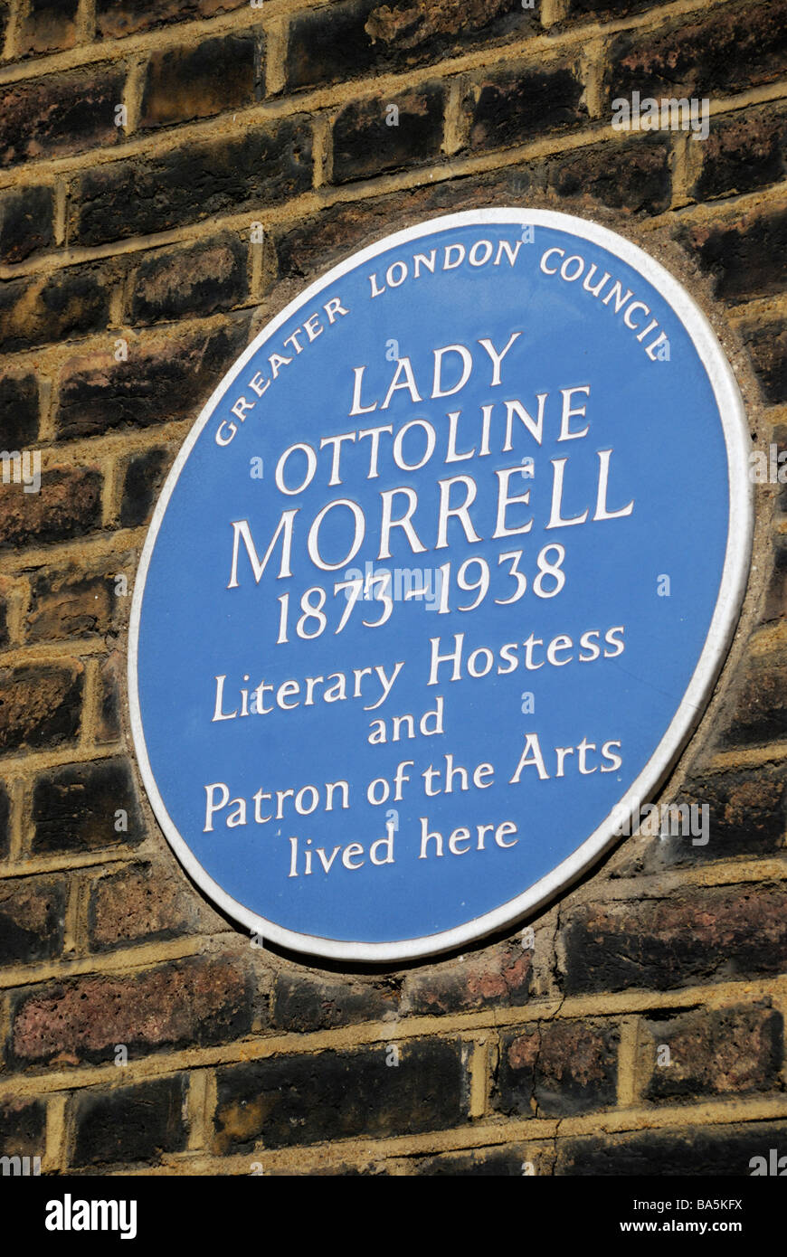 Blue plaque marking the former house of Lady Ottoline Morrell Literary Hostess and patron of the arts in Gower Street - Stock Image