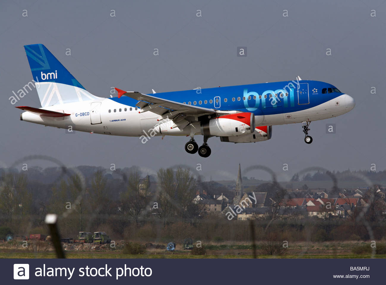 bmi Airbus flight approaching runway - Stock Image