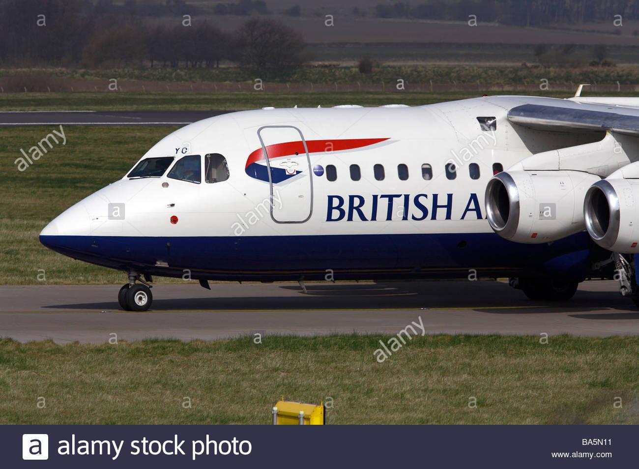 BA flight taxiing at airport Stock Photo