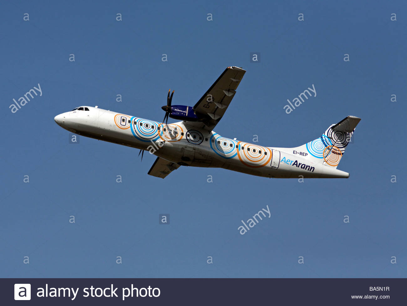 Aer Arann flight shortly after takeoff - Stock Image