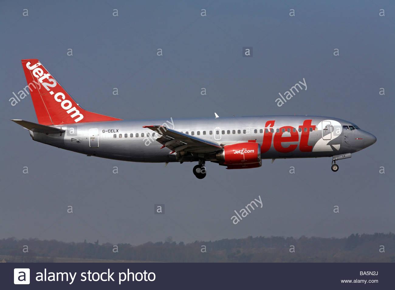 Jet2.com flight approaching runway - Stock Image