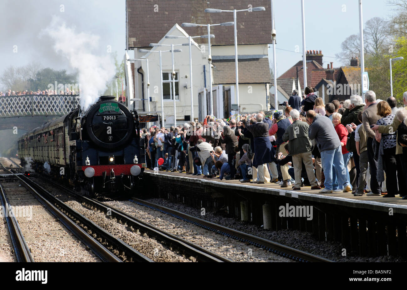 Oliver Cromwell steam engine pulling The Cathedrals Express train pulling into Petersfield railway station - Stock Image