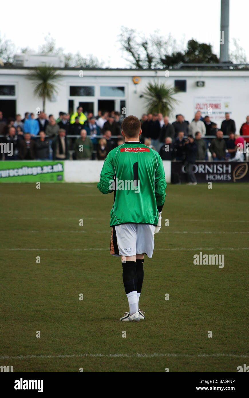 a view from behind of the truro city goalkeeper - Stock Image