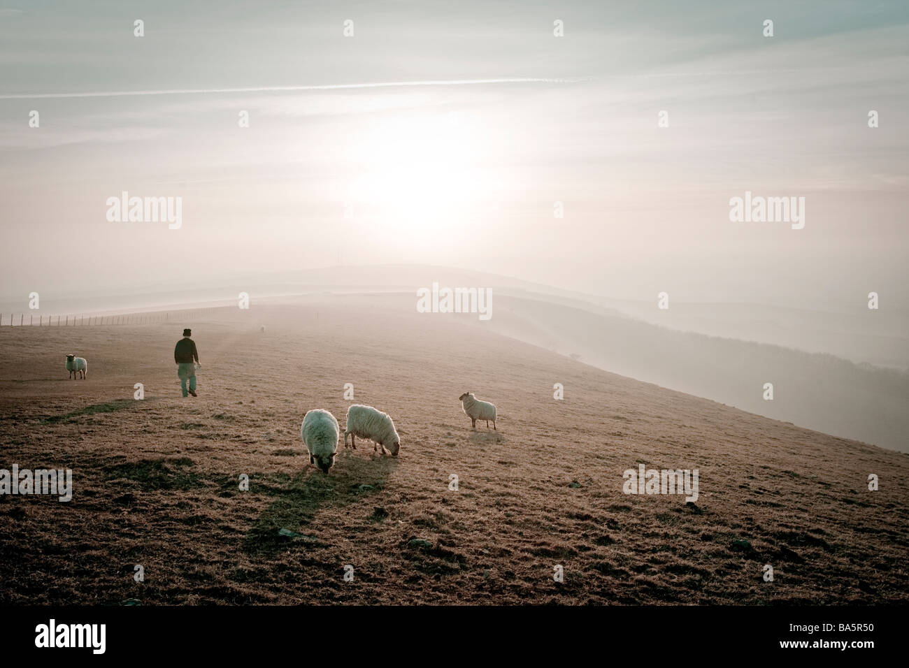 Hiker on The South Downs just before sunset. Near Alfriston, East Sussex, England, UK - Stock Image