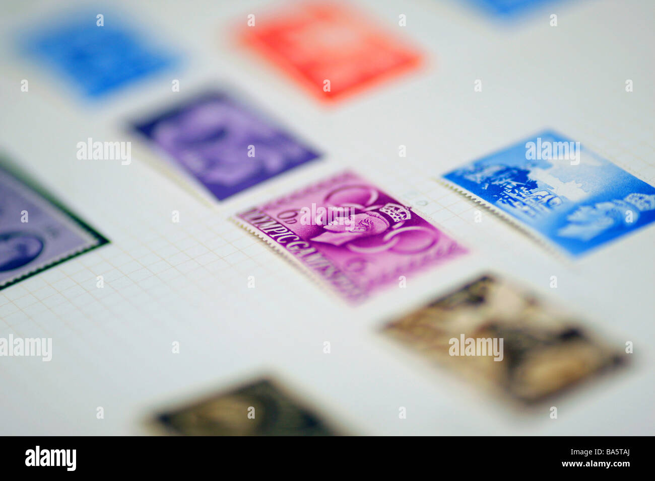 British stamps in an album 1940s showing Olympics commemorative - Stock Image