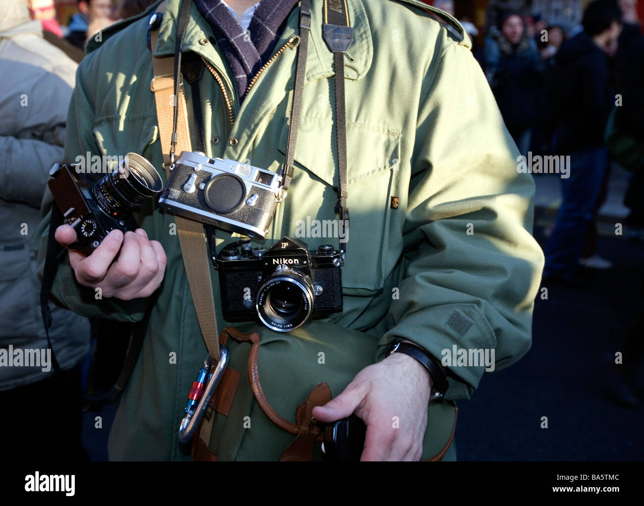 Classic cameras in use at Chinese New Year Celebrations, London. England. Europe Stock Photo