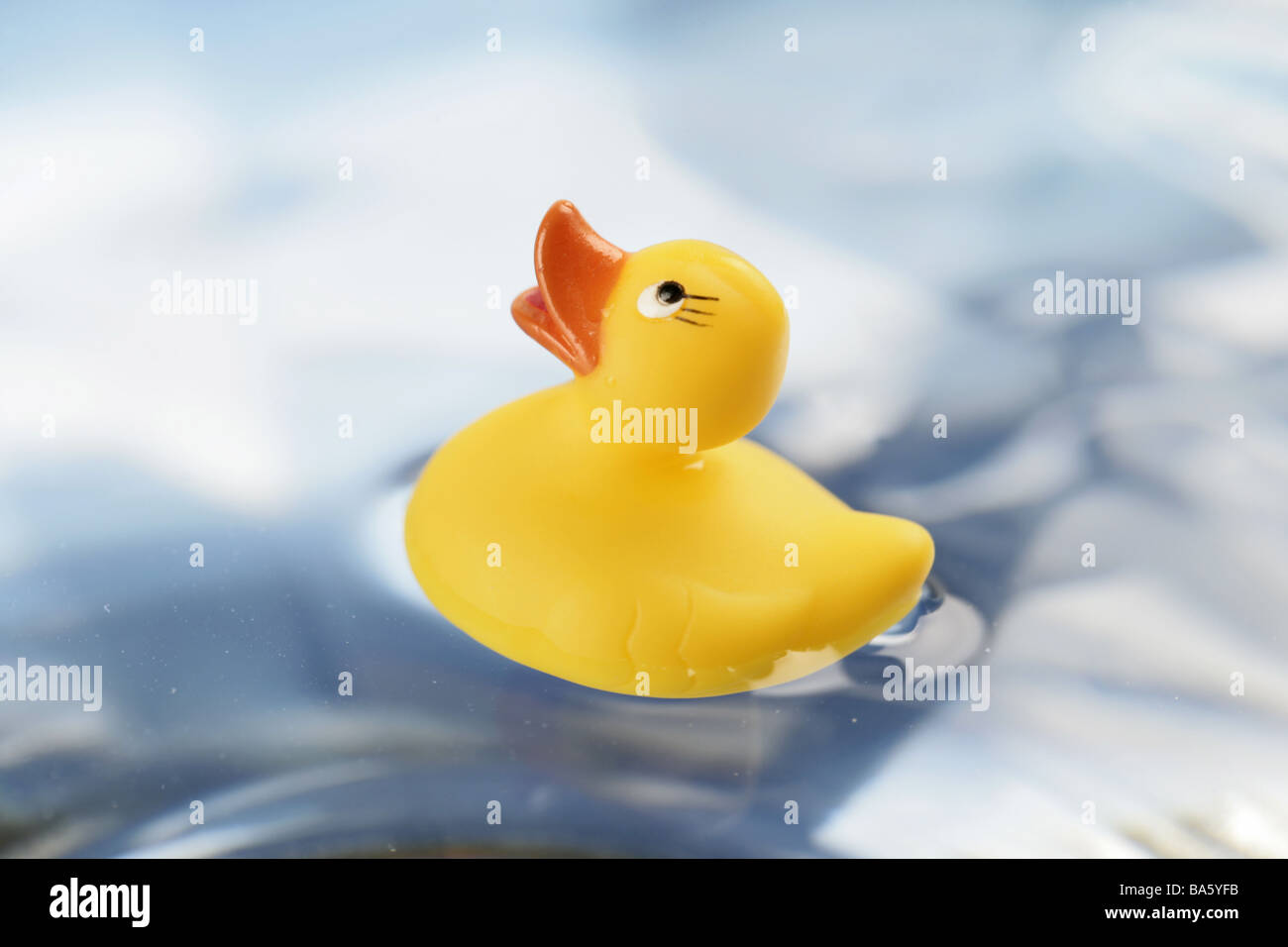 Water-surface bath-ducks yellow at the side toy toy plastic-duck toy-duck Quietscheente baby-toy bath-toy symbol - Stock Image