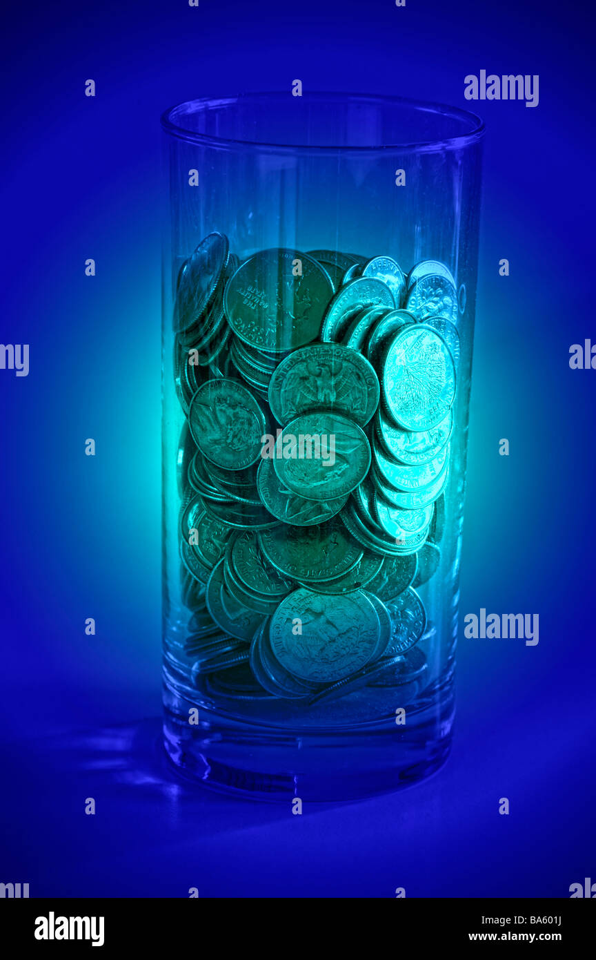 computer enhanced view glass filled with pennies Stock Photo