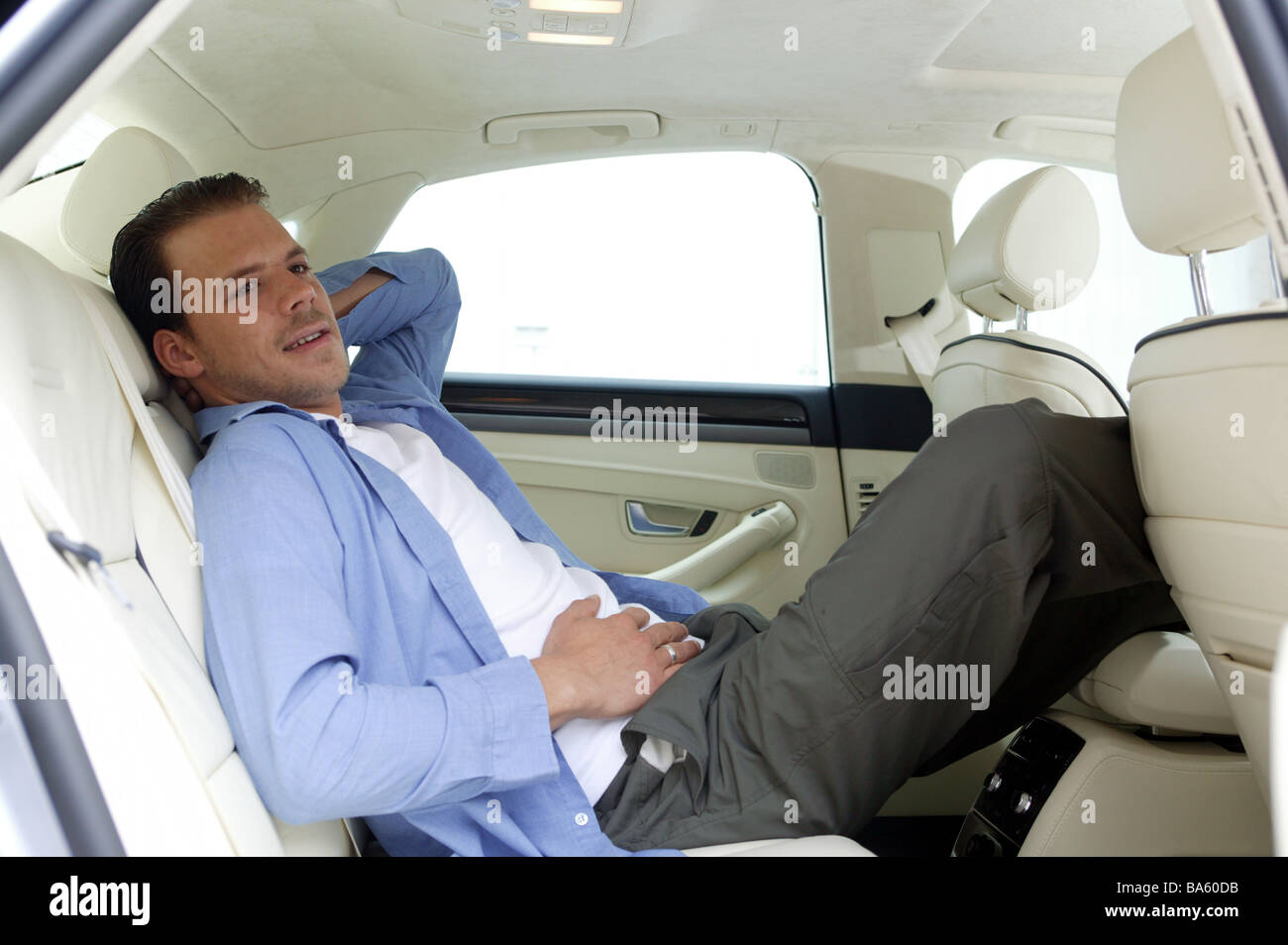 Man car back seat legs relaxen put up rela vehicle private car ...