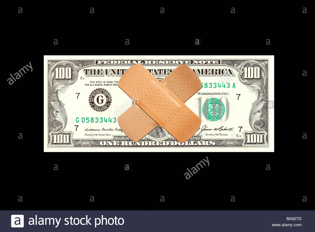 Bandages covering face of one hundred dollar bill - Stock Image