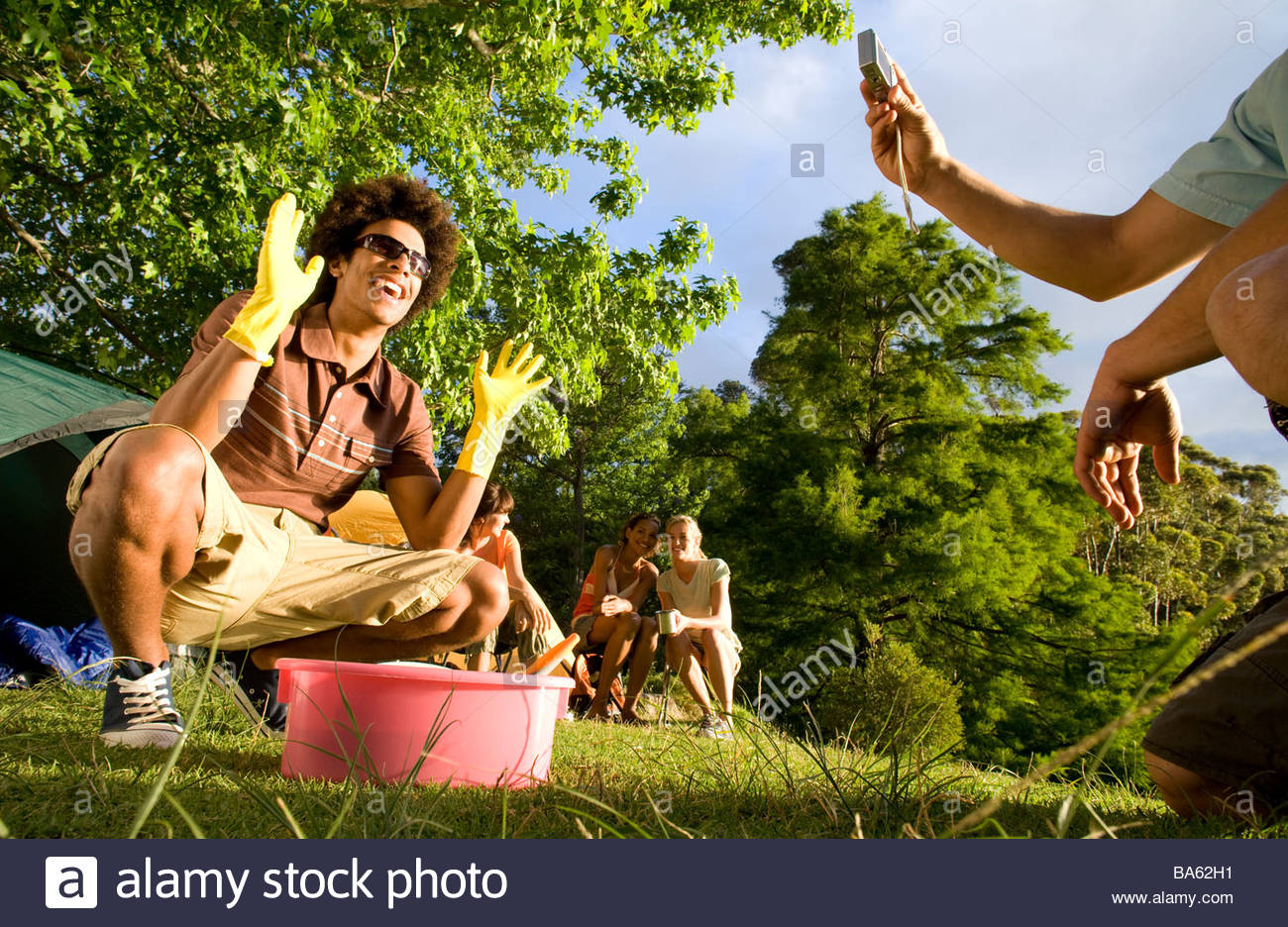 Friends camping - Stock Image