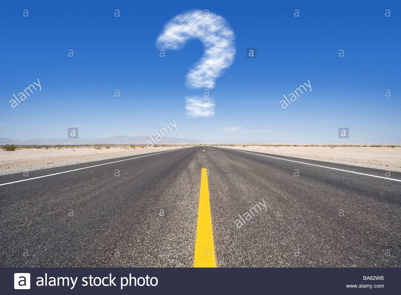 Question mark cloud hovering over remote desert road - Stock Image
