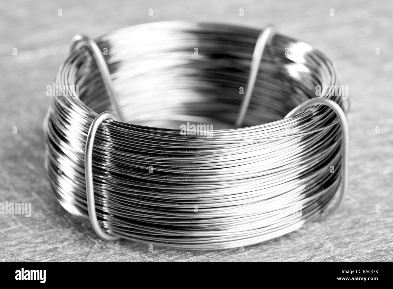 Coil of silver wire - Stock Image