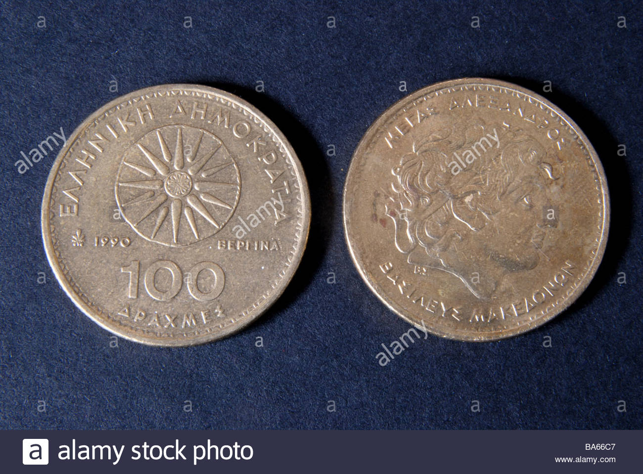 Front and rear of Greek 100 drachma coins. - Stock Image