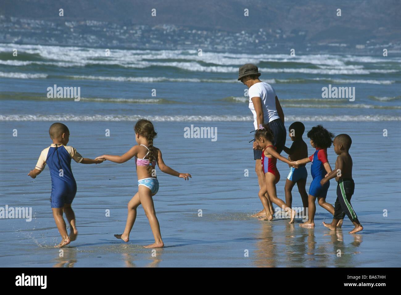 South Africa cape-peninsula False Bay Muizenberg beach senior children bath-clothing sea no models release Africa - Stock Image