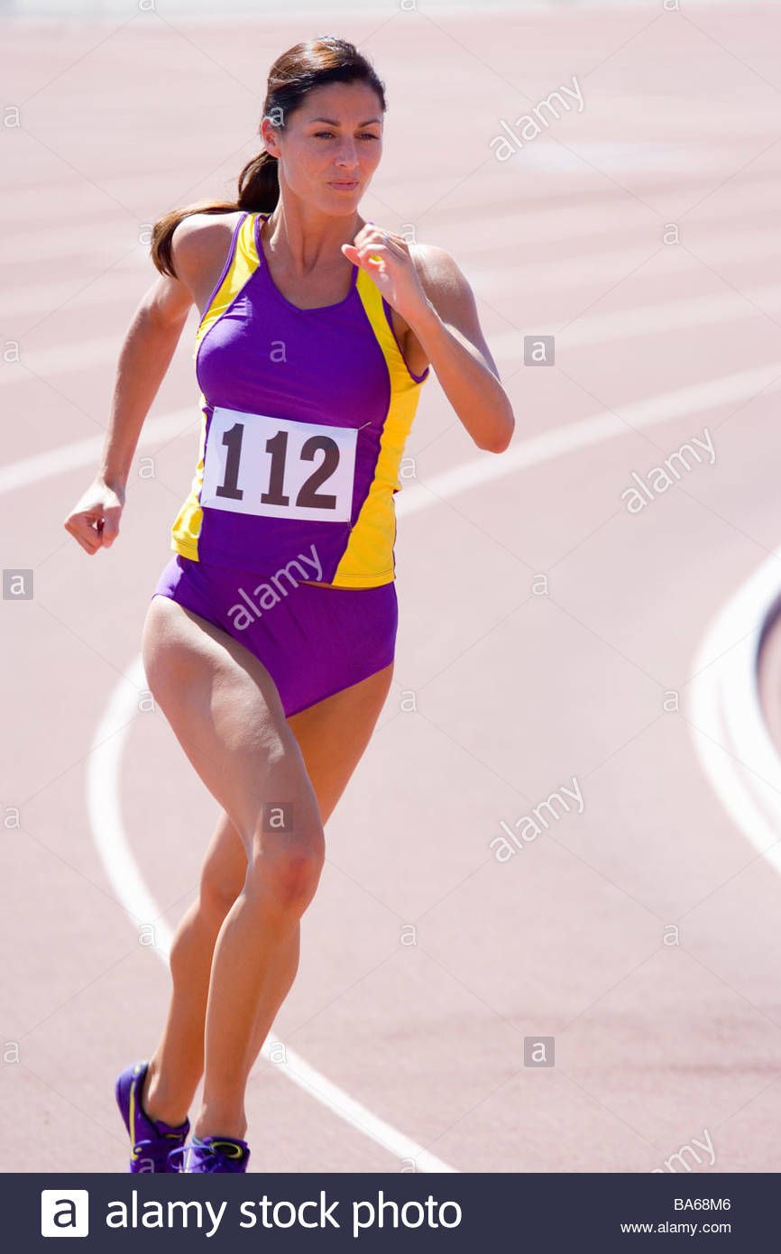 Female athlete running on race track Stock Photo
