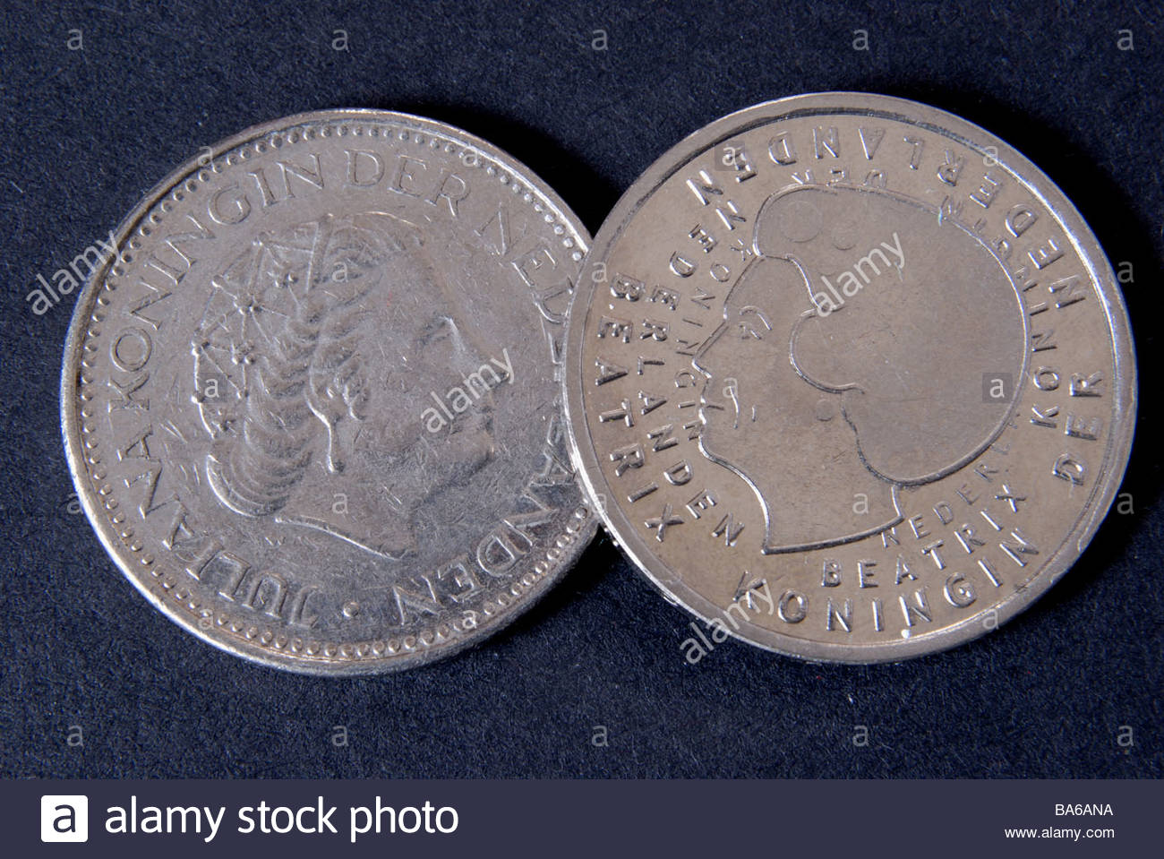 Dutch one guilder coins with the heads of Queens Juliana and Beatrix. - Stock Image