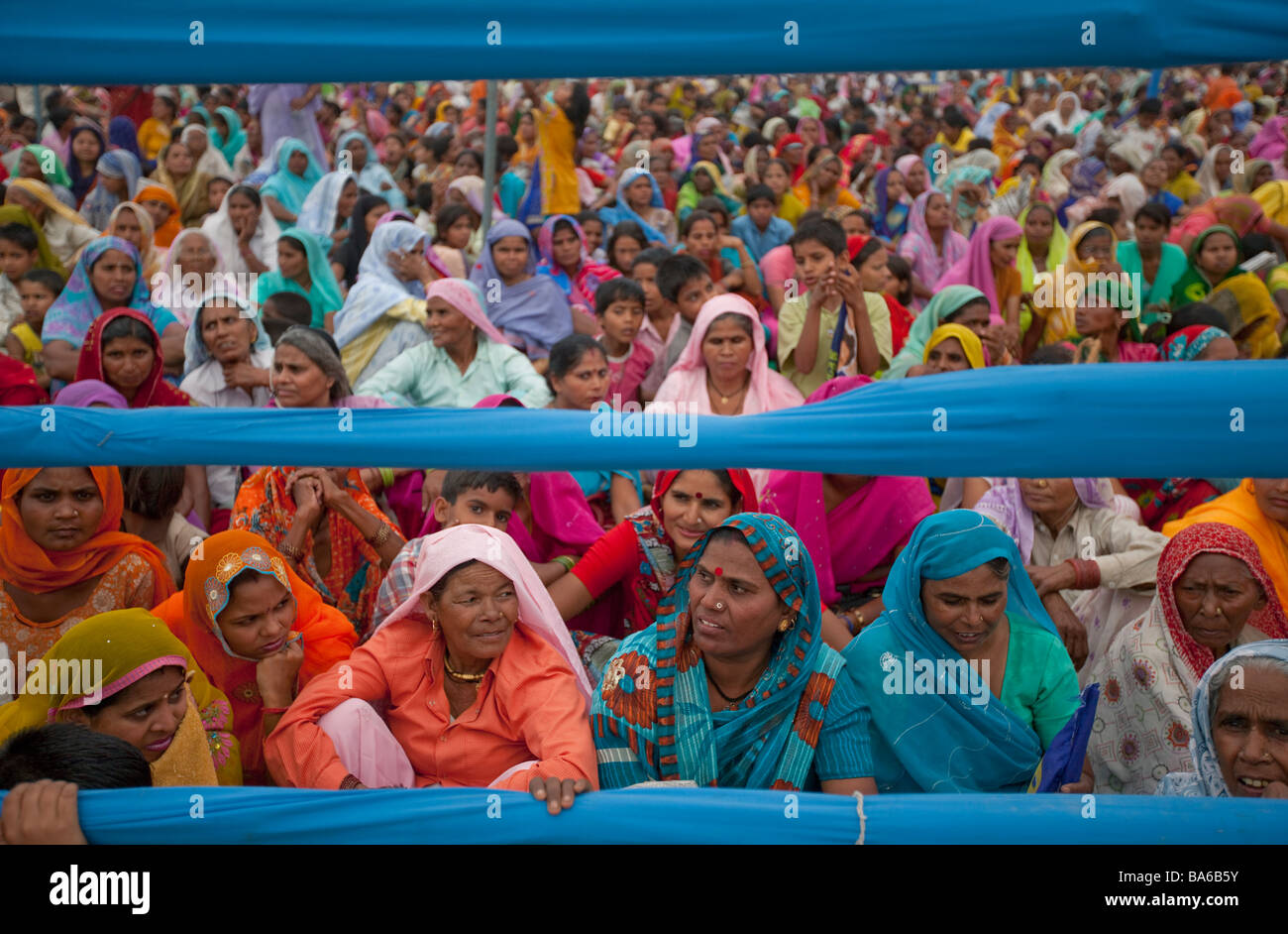 Female Mayawati supporters at a political rally in Palwal Haryana in the lead up to India's Lok Sabha elections - Stock Image