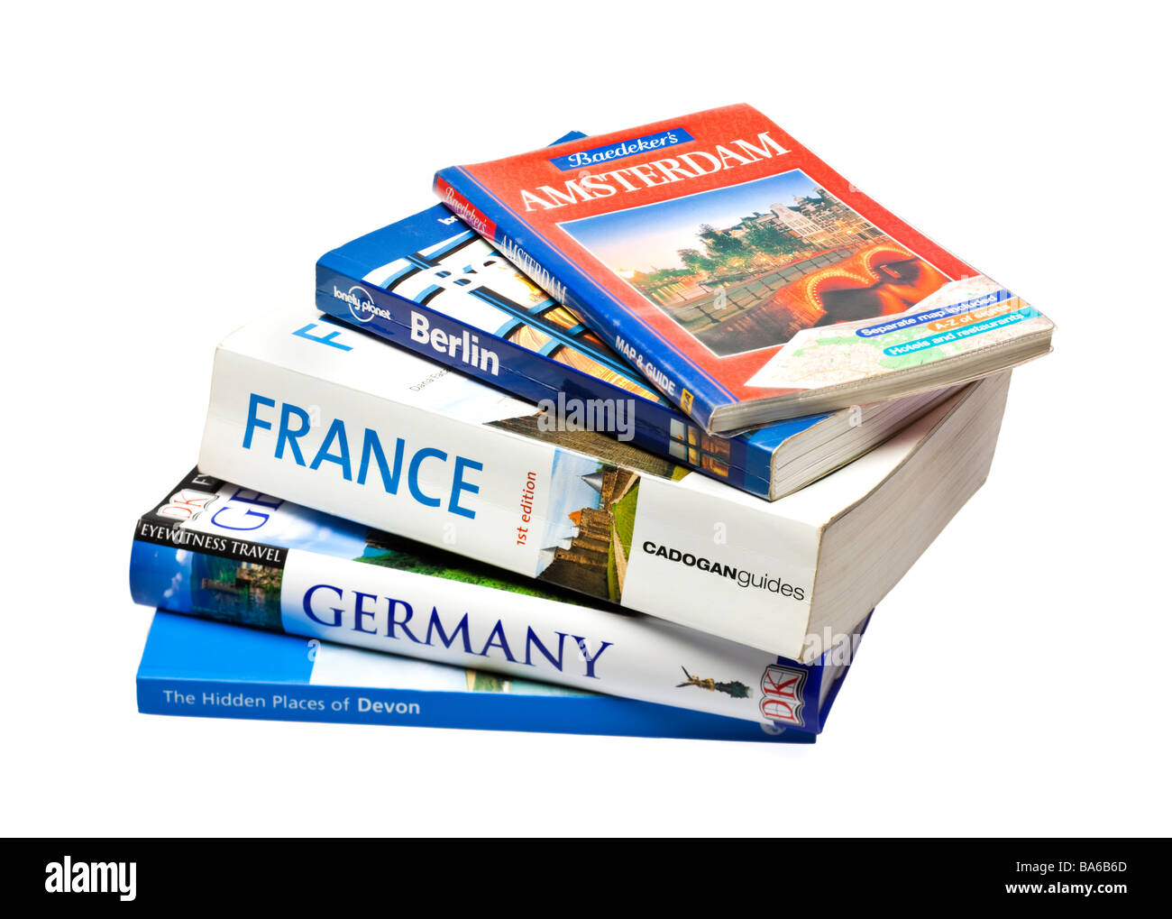 Stack of European travel guide books on white Stock Photo