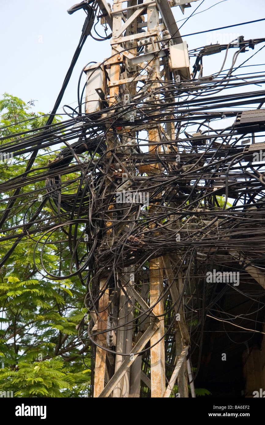 A tangle of telephone wires on a utility pole in Ho Chi Minh City Vietnam - Stock Image
