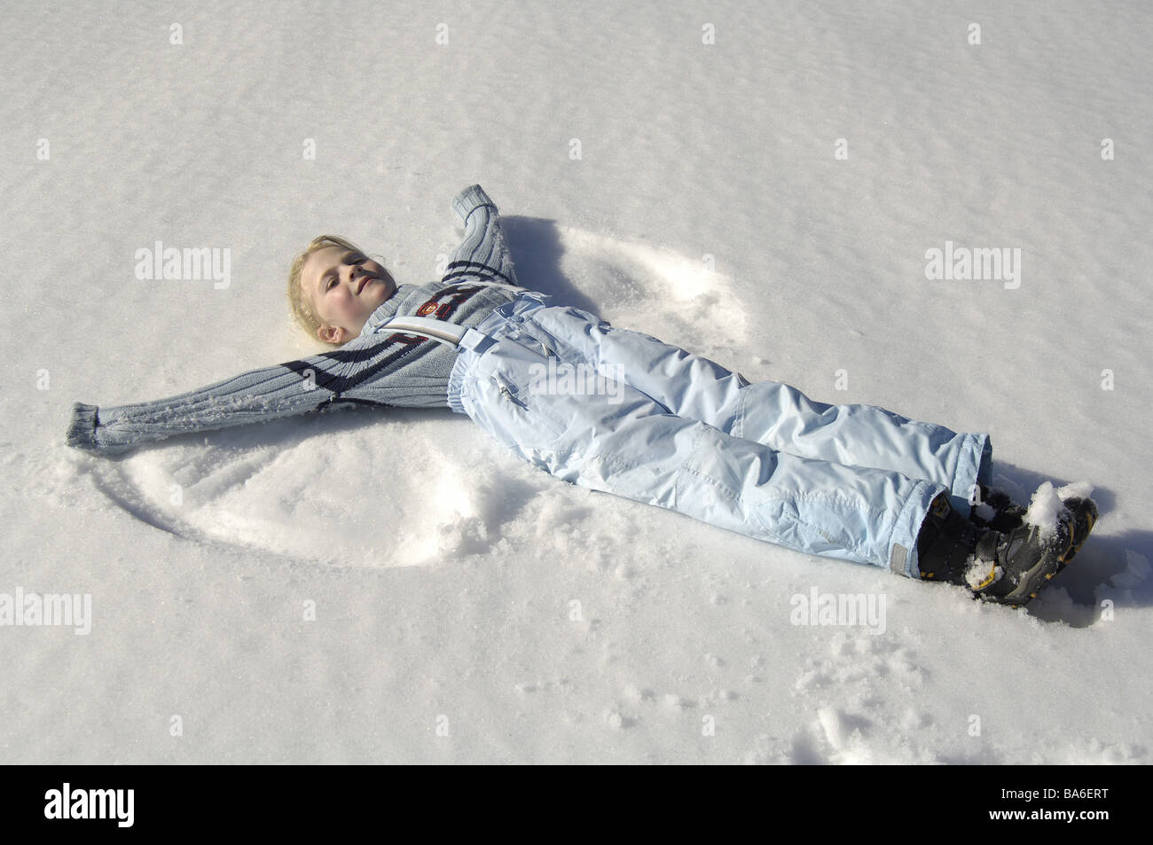 Lies child girls winter-clothing cheerfully snow mark 'angels' winters winter-landscape vacation vacation - Stock Image