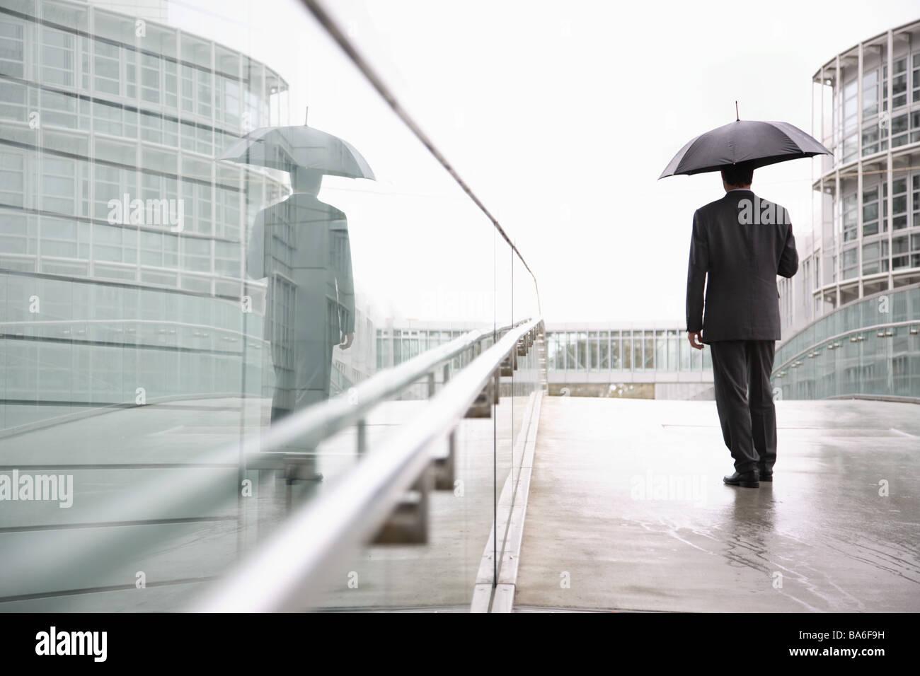 goes businessman umbrella back opinion series people man 30 40 years