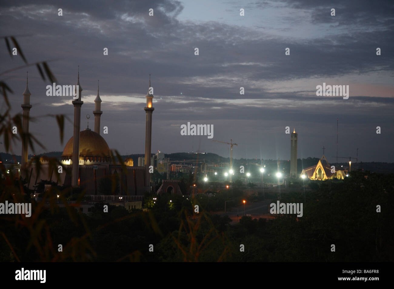 The grand Mosque and the main Church of Abuja, Capital of Nigeria by night. - Stock Image