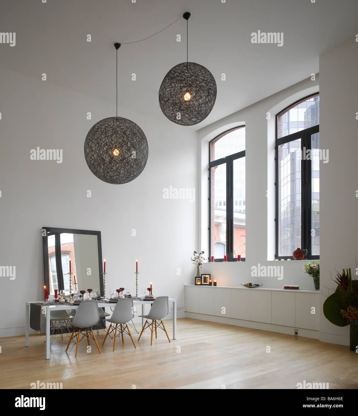 Dining area with oversized ceiling lights in apartment of converted dining area with oversized ceiling lights in apartment of converted royal mail sorting office london uk aloadofball Images