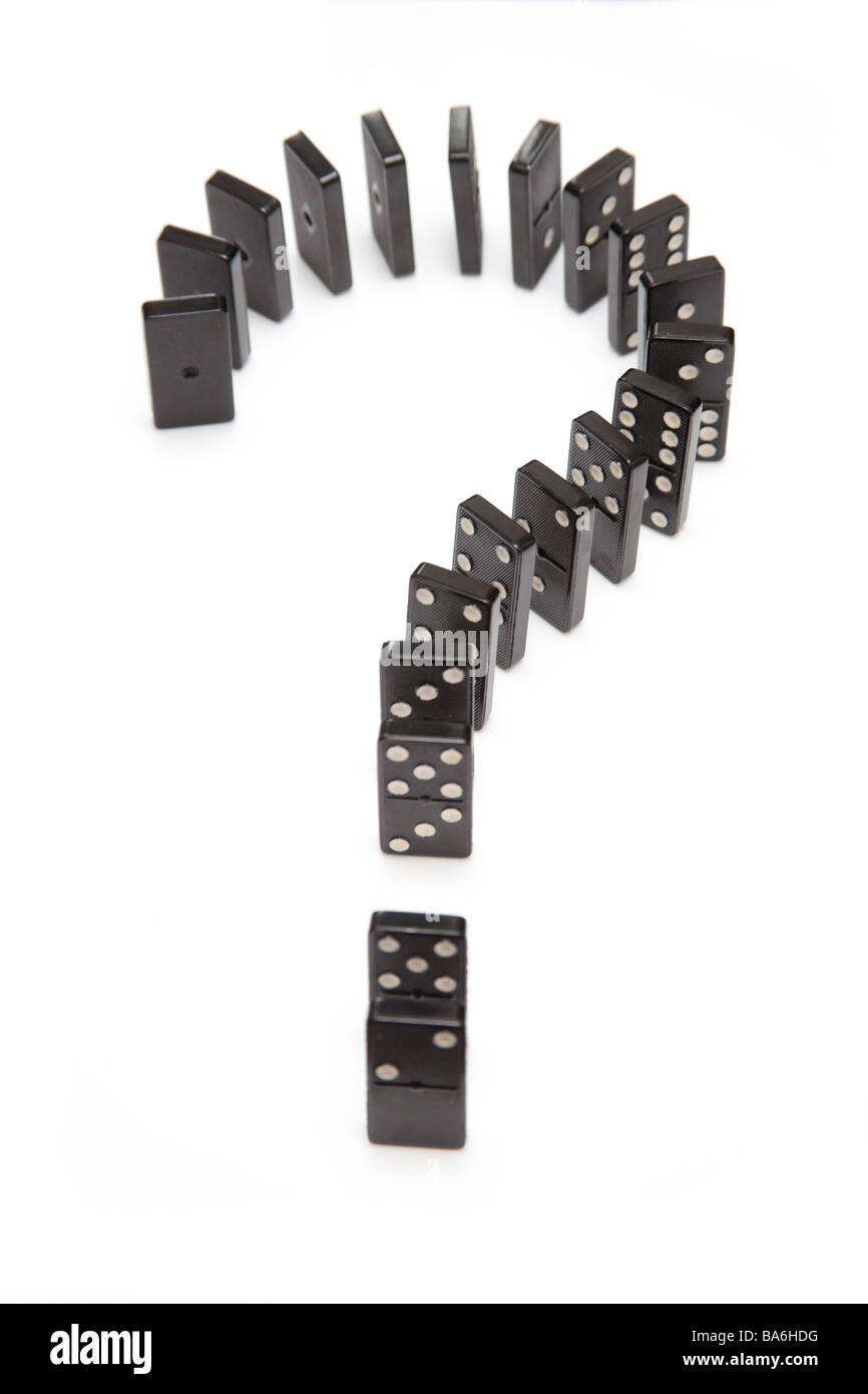 Domino's in the shape of a question ? mark isolated on a white studio background - Stock Image