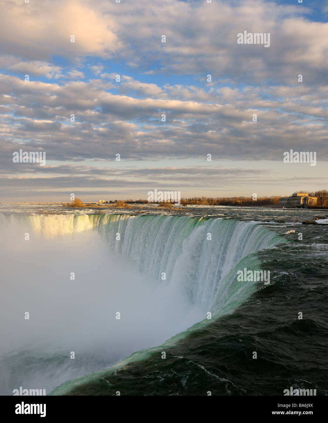 Sun on clouds at sunset at the Horseshoe Falls from Table Rock Canadian Niagara Falls Canada - Stock Image