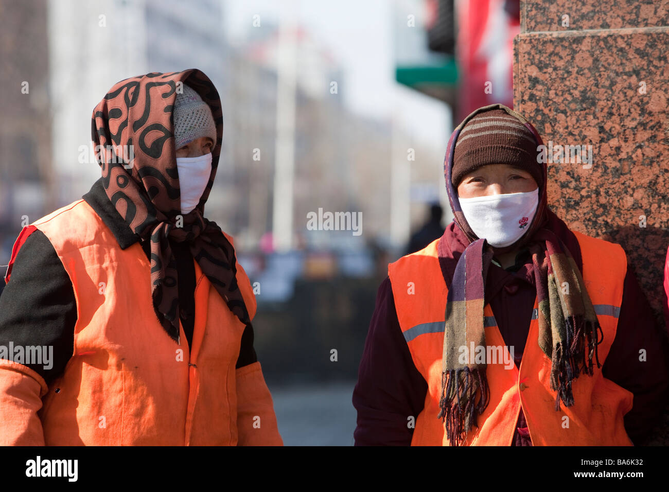 women wearing a smog mask against the awful air pollution in Shihua city in northern China - Stock Image