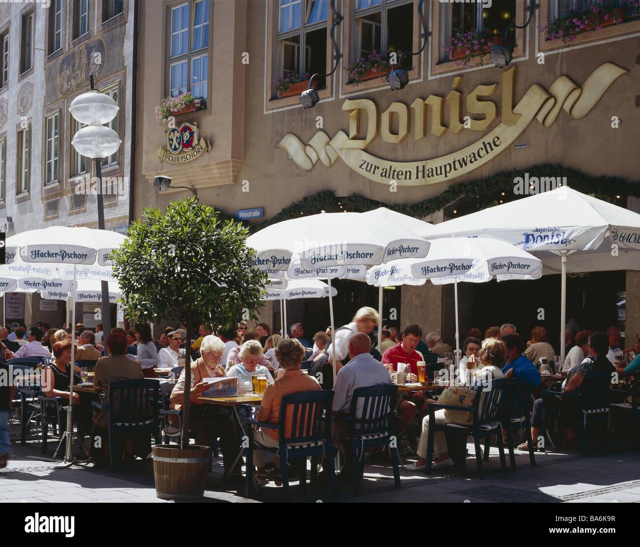Germany waiter-Bavaria models Munich Marie-place street-cafe Donisl guests no release Bavaria sociability symbol - Stock Image