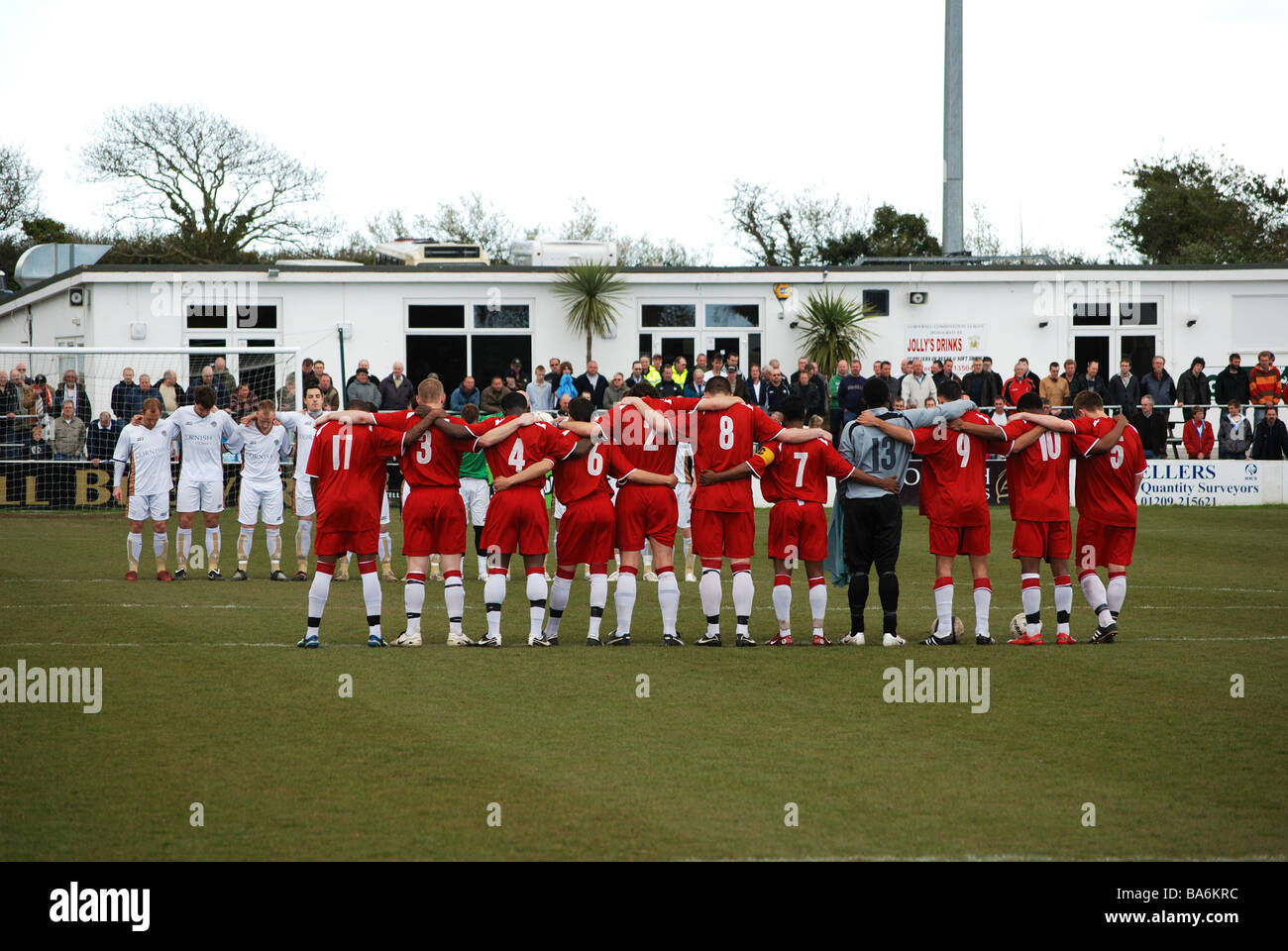 football players observing a minutes silence before the game between truro city and afc hayes - Stock Image