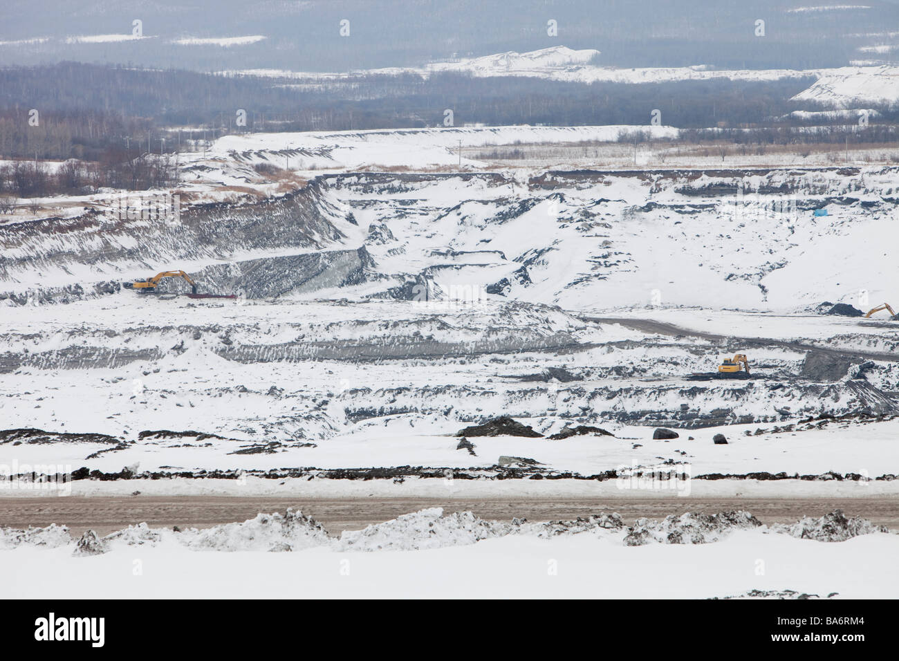 low grade coal being extracted from an open cast coal mine near Heihe on the Chinese Russian border. Stock Photo