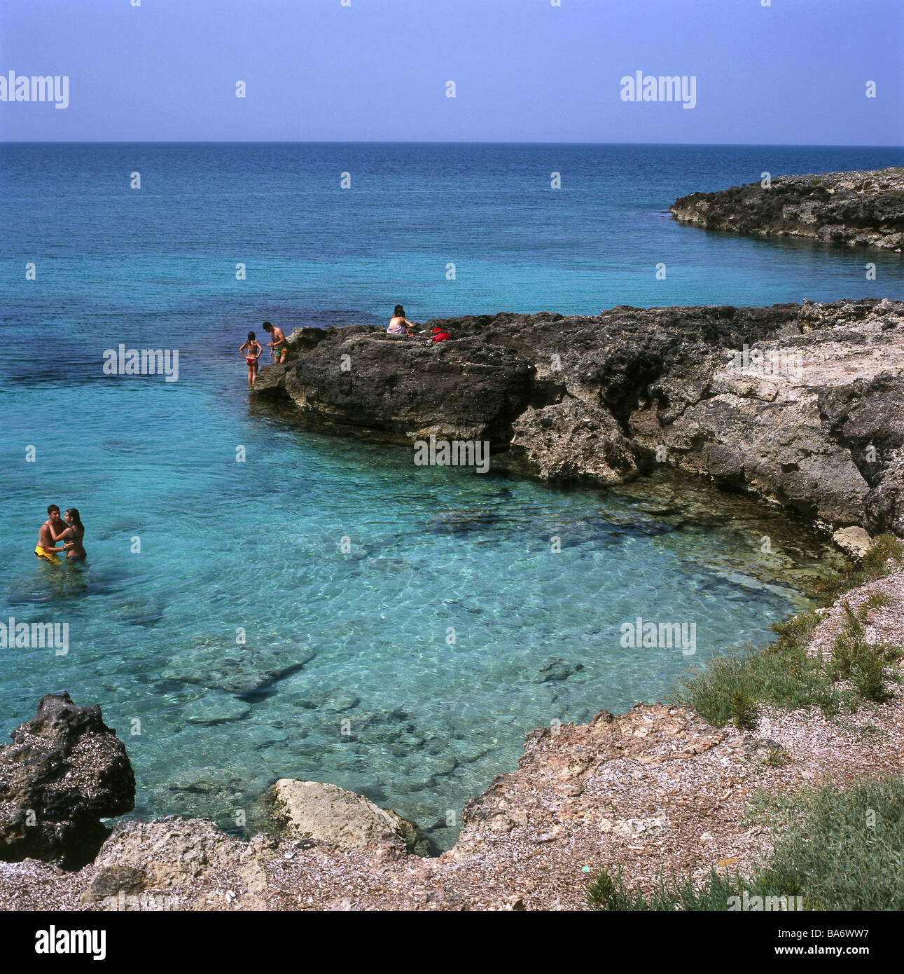 Italy Apulien Capilungo rock-coast swimmers no models release South-Italy southern Salento coast tourists bath-fun - Stock Image