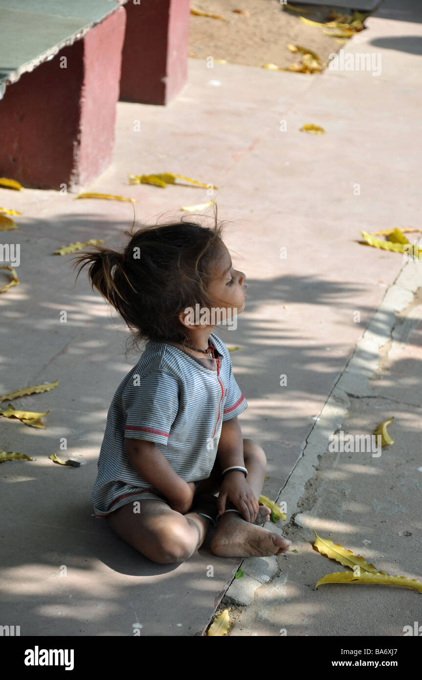 A Child watching her mother at the Ghandi Ashram, Ahmedabad - Stock Image