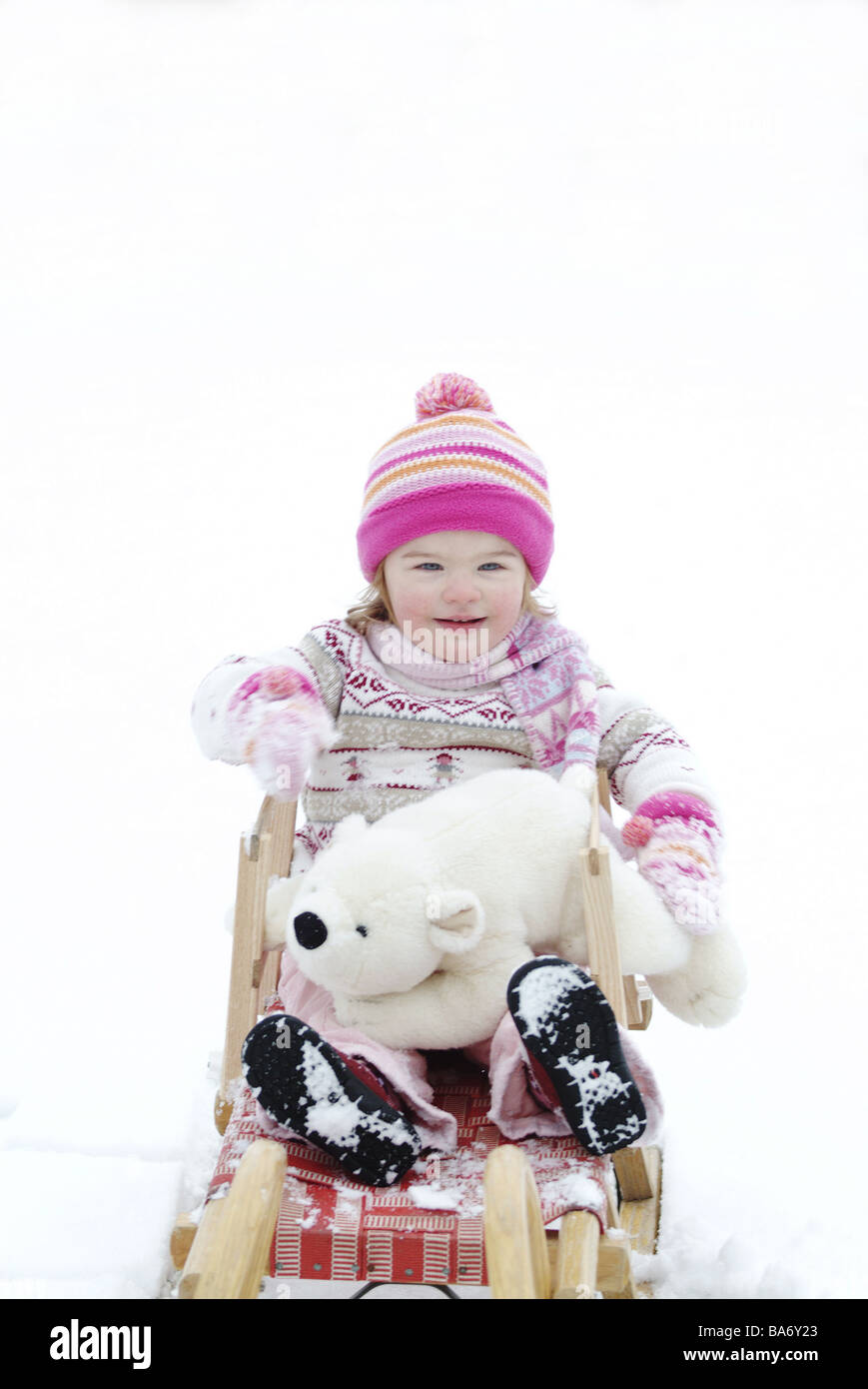 Child girls winter-clothing cheerfully material-animal 'polar bear' sled snow people toddler 2-4 years cap - Stock Image