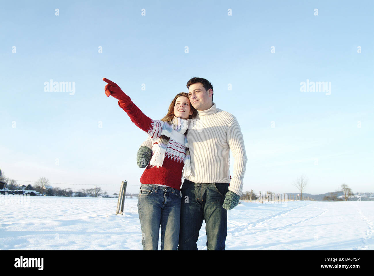 Mate young falls in love cheerfully woman gesture interprets gaze distance walk winter-landscape people two 30-40 - Stock Image